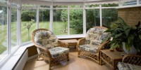 conservatory tables chairs plants room in house next to garden