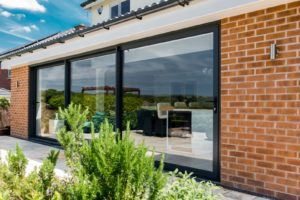 What are the best patio door designs? Take a look at the benefits of bifolds, sliding doors & French doors. Install new patio doors which are functional & attractive. Chat to an expert now about replacement patio doors.